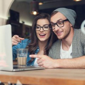 Couple-Wearing-Eyeglasses-at-Computer